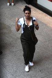 Eva Longoria Shows off her baby bump in overalls as she has lunch with a friend in Miami