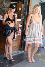 Georgia Gibbs and Kate Wasley leave coffee shop in Sydney