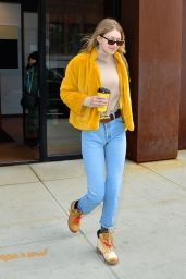 Gigi Hadid All smiles leaving her apartment in a yellow fluffy coat in NYC