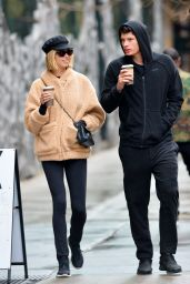 Hailey Clauson and boyfriend Julian Herrera are pictured sipping coffees while out on a stroll in New York City