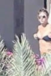 Jennifer Aniston Enjoying the warm rays as she sunned by the pool in a tiny bikini in Cabo San Luca