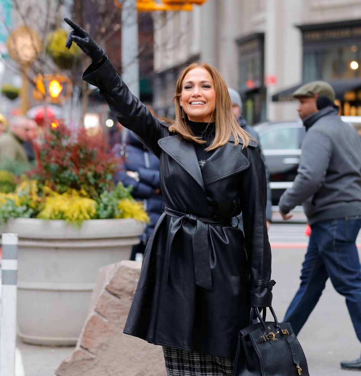 e428bb3c58 Jennifer Lopez Hails cab in midtown after filming with friend