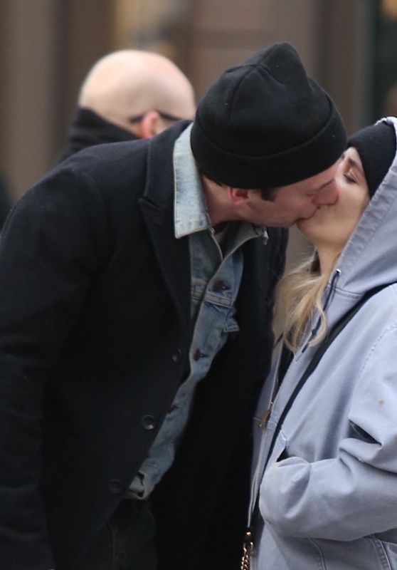 Jeremy Allen White and Addison Timlin stopping to kiss while shopping in Soho