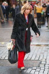 Kate Garraway Is all smiles while waiting for an Uber outside the Global Radio Studios in London, England