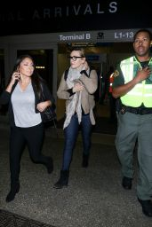Kate Winslet Keeps bundled up as she touches down in Los Angeles at LAX