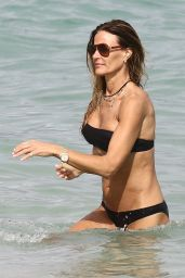 Kelly Bensimon Seen showcasing her bikini body in a 2 different two-pieces on the beach in Miami