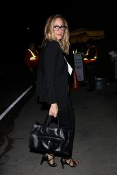 Kim Raver Carries a bottle of Moet champagne in hand as she goes to Jennifer Klein