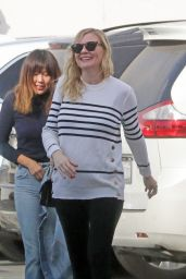 Kirsten Dunst All smiles as she leaves an office building in Santa Monica