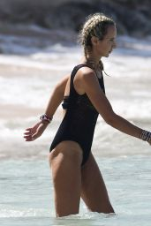Lady Victoria Hervey In a black swimsuit on the beach in Barbados