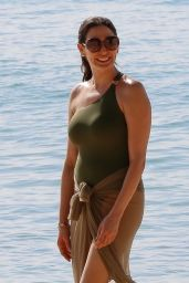 Lauren Silverman Wearing a green swimsuit while enjoying white sandy beaches on holiday in Barbados