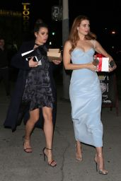 Lea Michele Dines out with a friend at a holiday party in Los Angeles
