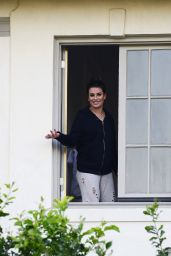 Lea Michele On friends balcony after escaping her home after the Los Angeles wildfires destroying her neighborhood