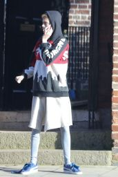 Make up free Cara Dalevingne dresses down in an oversized hoodie and leggings as she enjoys a low-key outing in London
