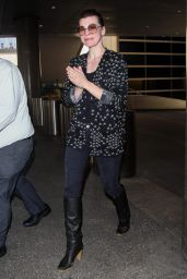 Milla Jovovich Arriving on a flight at LAX airport in Los Angeles