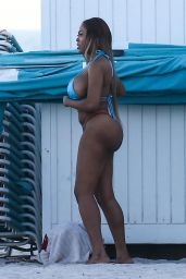 Moriah Mills Is spotted out posing for a photoshoot on the beach in Miami