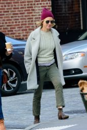 Naomi Watts Wears a cable knit sweater, light grey pea coat and purple beanie as she goes for a walk in Tribeca, New York City