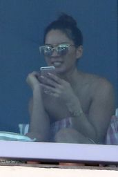 Olivia Munn Wears a short gingham dress as she relaxes in Miami