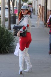 Phoebe Price Eats a snack curbside while shopping in Beverly Hills