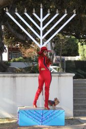 Phoebe Price Poses in front of a gigantic menorah in Beverly Hills