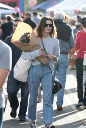 Phoebe Tonkin Picks up flowers at the Farmers Market in Los Angeles