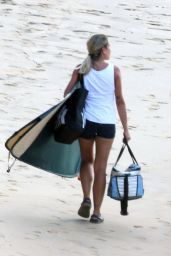 Pregnant Candice Swanepoel showed off her killer figure in a Sizzling Ivory Swimsuit as she hits the beach on the Island In BZ