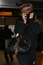 Rita Ora Keeps just one eye uncovered as she arrives at London