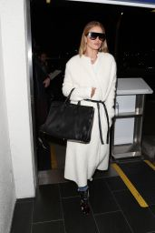 Rosie Huntington-Whiteley Looks cat walk ready as she arrives for a flight out of Los Angeles