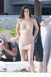 Sara Sampaio Posing for a photoshoot in a white bikini and a barely-there tan dress at a beach resort in Playa del Carmen, Mexico