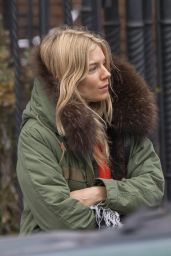 Sienna Miller Hails a Cab While Bundled Up in a Green Parka - New York