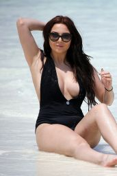 Amelia Goodman Pictured looking fabulous in a black swimsuit while relaxing in the Bahamas