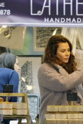 Anna Friel Is seen filming scenes as a market stall seller selling soap in Manchester City Centre