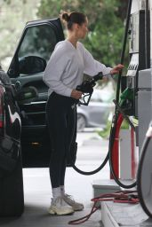 Bella Hadid Looking chic while pumping gas and checking her tire at the gas station in Beverly Hills