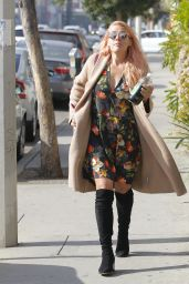 Busy Phillips All smiles while getting some Kreation Juice in West Hollywood