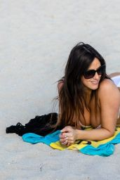 Claudia Romani Plays with a Lemur while enjoying a day at the beachin Miami