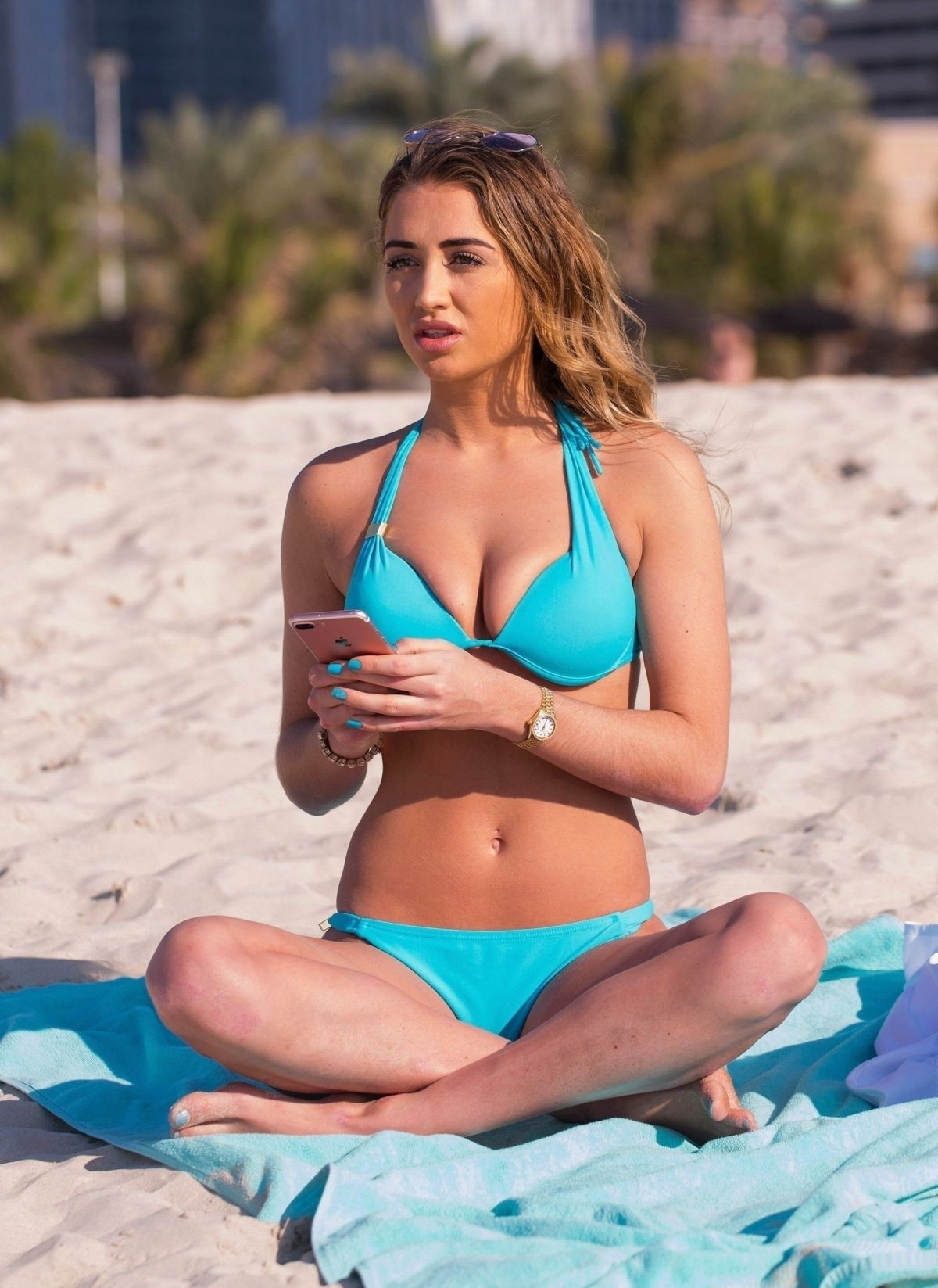 Georgia Harrison Shows off her curves on the beach whilst on holiday in Dubai