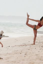 Nina Dobrev Doing yoga at a beach in Mexico