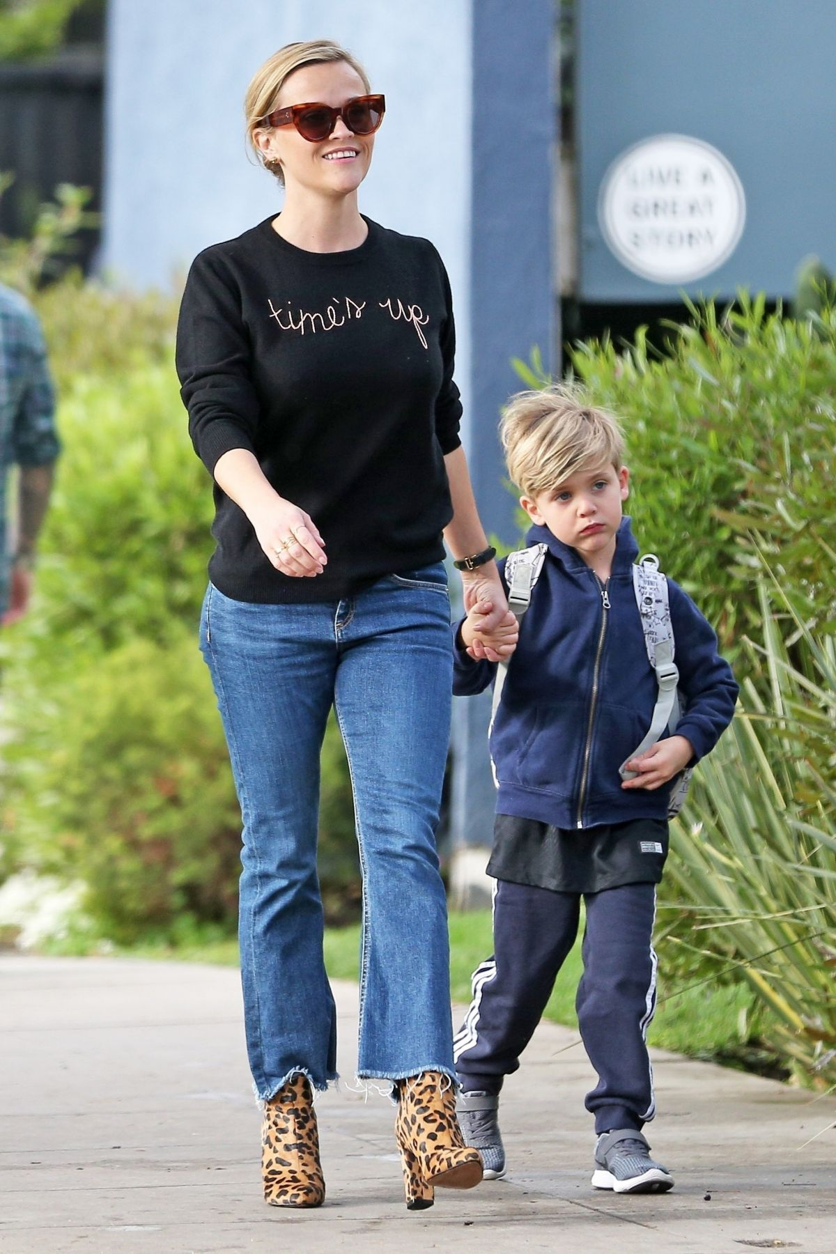 Reese Witherspoon Rocks a Times Up shirt while dropping