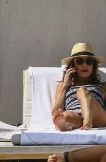 Bethenny Frankel Goes for a walk and then lounges by the pool showing off her bikini body in Miami Beach