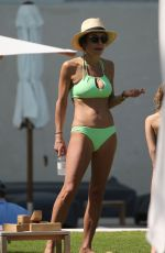 Bethenny Frankel Shows off her curves in a neon yellow bikini in Miami