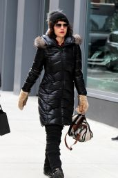 Carla Gugino and her husband Sebastian Gutierrez pictured running errands Downtown