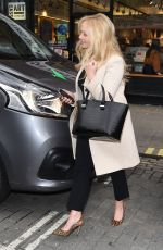 Emma Bunton Looks chic in a winter coat and cheetah print heels while arriving at Capital FM, London