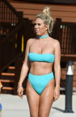 Frankie Essex Enjoying a dip in the pool wearing a blue high waisted bikini in Portugal