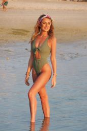 Georgia Harrison Sizzles in the sun wearing a skimpy green swimsuit spotted posed on the beaches of Dubai