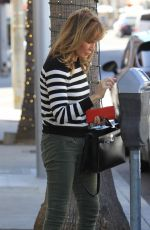 Jaclyn Smith Is spotted out feeding the meter while out in Beverly Hills