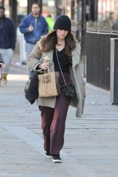 Keira Knightley Out for a walk in a Burberry coat and black woolly hat in North London