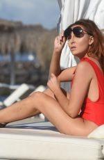 Laura Simpson Puts on a sexy display with her red swimsuit on the beach in the Canary Islands
