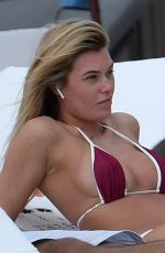 Samantha Hoopes Shows off her curves in a very skimpy bikini on the beach in Miami