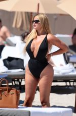 Anastasia Kvitko In a swimsuit that showed off her famous curves at the beach in Miami