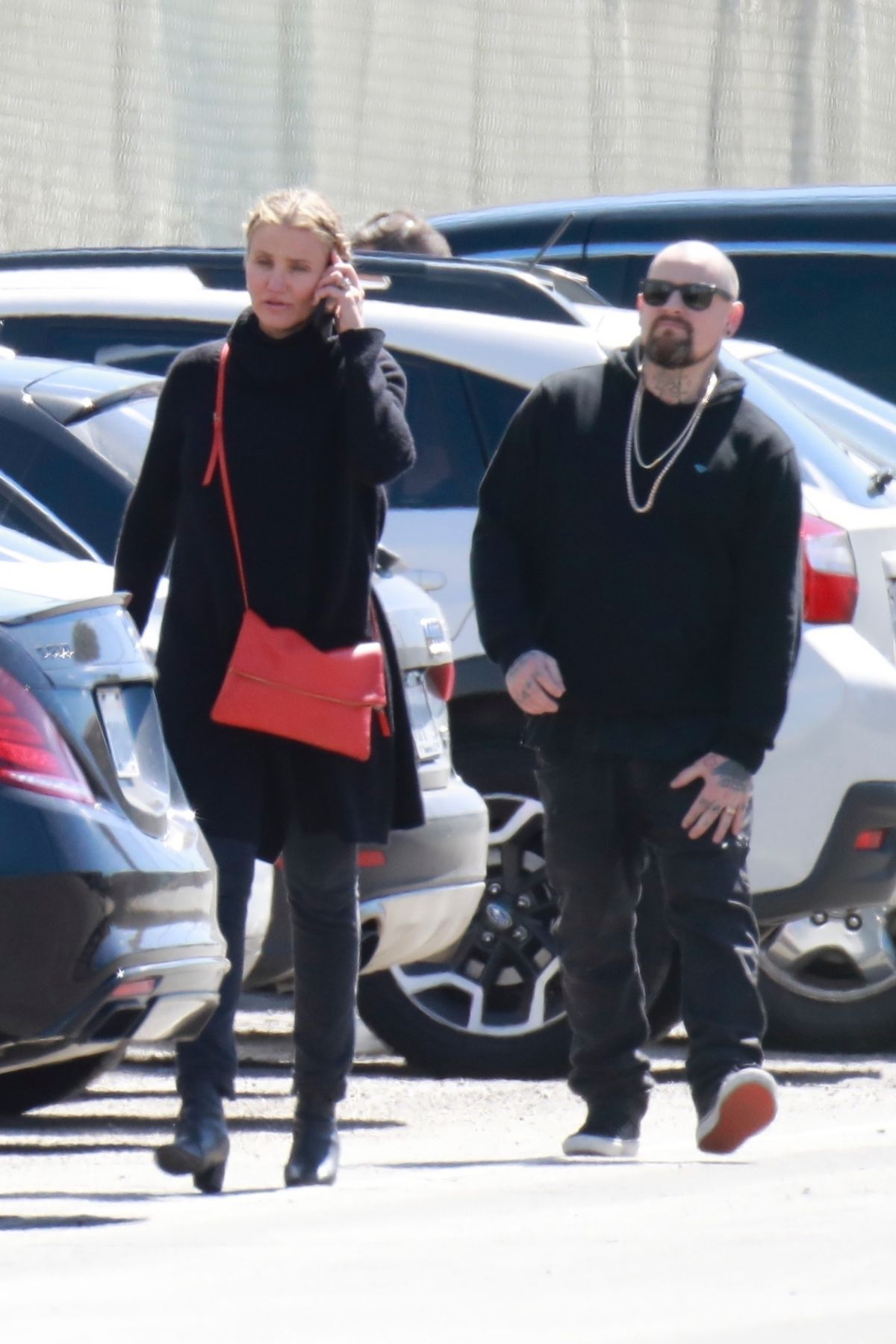 cameron diaz and her husband benji madden are seen arriving to a st