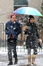 Carla Gugino Walking through Washington Square Park with her family on a blizzard like snowy day in New York